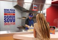 Domino's 10,000th store, opened today in Istanbul, Turkey, features a viewing area where customers can see their pizzas being made fresh. (PRNewsFoto/Domino's Pizza)