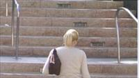 Woman walking up steps - BSN