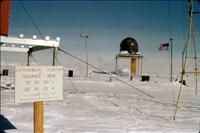 Henry Brecher, Ohio State University, research associate (now retired) at Byrd Polar Research Center, took this picture in winter 1959-1960. The sign reads: Astronomical Position Observed Here. Credit: Photo by Henry Brecher, courtesy of Ohio State University. Usage Restrictions: None